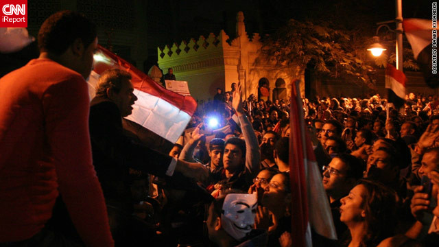 By December 4, protests had gotten larger and anti-government demonstrators &lt;a href='http://ireport.cnn.com/docs/DOC-891041'&gt;marched on the presidential palace&lt;/a&gt; in Cairo, as seen in this image by iReporter Maged Eskander. Crowds shouted &quot;liar&quot; in reference to Morsy and chanted anti-Muslim Brotherhood slogans. 