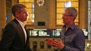 Apple CEO Tim Cook, right, chats with NBC News\' Brian Williams outside the Apple store in New York City\'s Grand Central Station.