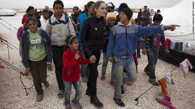 Angelina Jolie, special envoy for the U.N. refugee agency, meets with Syrian refugees at the Zaatari refugee camp outside Mafraq, Jordan, on December 6.