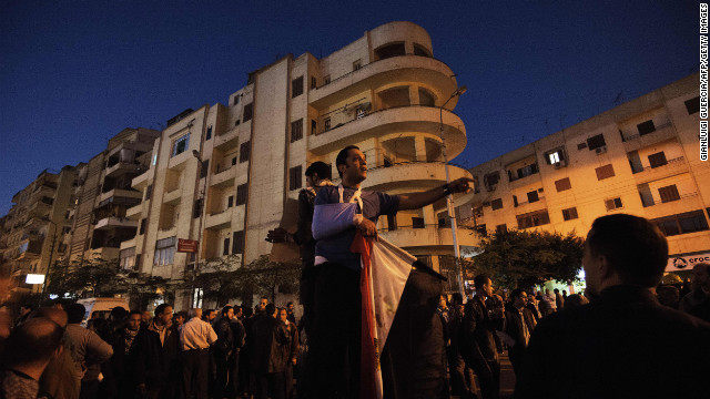 An anti-Morsy protester shouts during a march to the presidential palace in Cairo, Egypt, on December 6.