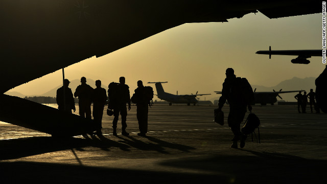 (File photo) Soldiers of the German Army Bundeswehr stand next to a cargo plane in Kabul, Afghanistan on November 12.