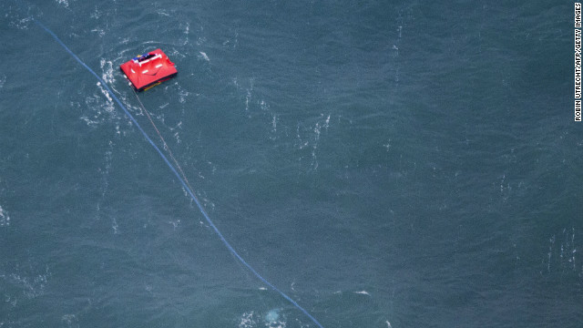 A red buoy marks the spot where the cargo ship