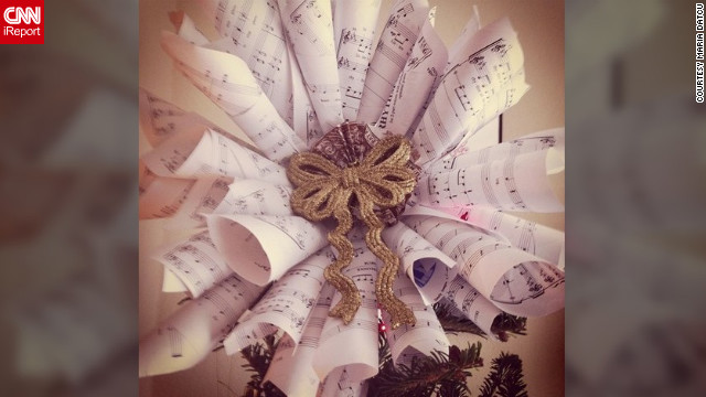 "Maria Datcu (@marialovescoco) of Tampa, Florida, made a tree topper from music sheets that her boyfriend used when he was young. ""It's our first Christmas together, so I wanted to personalize our decorations as much as possible."""