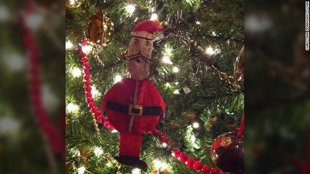 """Every Christmas Eve as a kid, I'd go to work with my dad. When I was about 10, I raided his highlighters and permanent markers and started making ornaments out of office supplies. This jolly Santa was my best creation. It's been on the tree ever since."" -- Christina Zdanowicz (@stinaz27), CNN iReport producer"