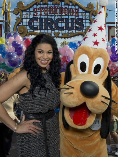 Jordin Sparks poses with Pluto at Walt Disney World Resort's new Fantasyland in the Magic Kingdom.
