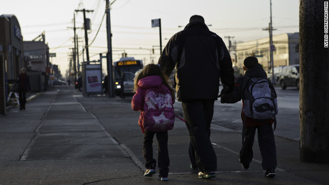 Joe Panetta walks his youngest kids to a bus stop before school<!-- -->.</br>