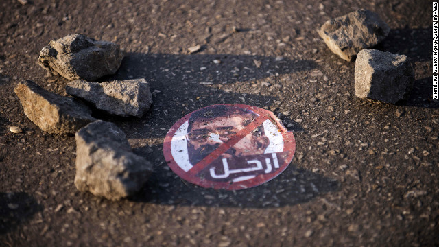A sticker depicting Egyptian President Mohamed Morsy reads &quot;leave&quot; on the ground near the presidential palace on December 8.
