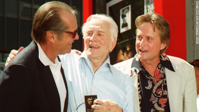 Actor Jack Nicholson greets Kirk Douglas and his son, Michael, after a ceremony honoring Michael, who placed his hands and footprints in cement at Grauman's Chinese Theatre in 1997. Michael Douglas is the first &quot;second generation&quot; movie star to be honored. Kirk Douglas' handprints were imprinted there in 1962. 