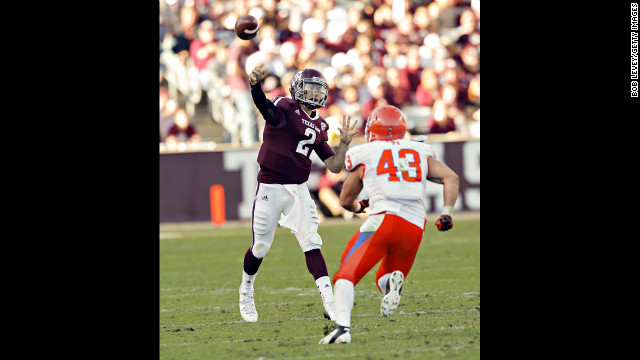 Manziel throws downfield as Jesse Beauchamp of the Sam Houston State Bearkats applies pressure at Kyle Field on November 17.