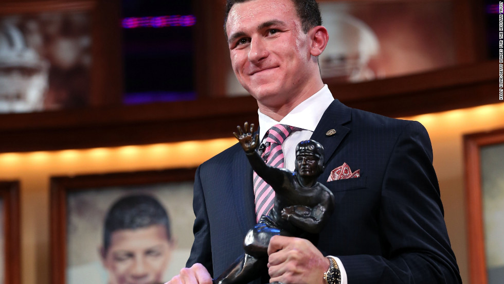 Quarterback Johnny Manziel of the Texas A&amp;amp;M University Aggies poses with the Heisman Memorial Trophy after being named the 78th Heisman Memorial Trophy Award winner at the Best Buy Theater on December 8 in New York City.