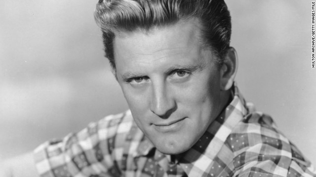 "Kirk Douglas was born in Amsterdam, New York, on December 9, 1916. He made his Broadway debut in 1941, served in the U.S. Navy and embarked on a screen career in 1946. Popular films include ""20,000 Leagues Under the Sea,"" ""Spartacus"" and ""The Bad and the Beautiful."" Douglas also worked as director. Douglas is shown in a studio portrait, circa 1955."