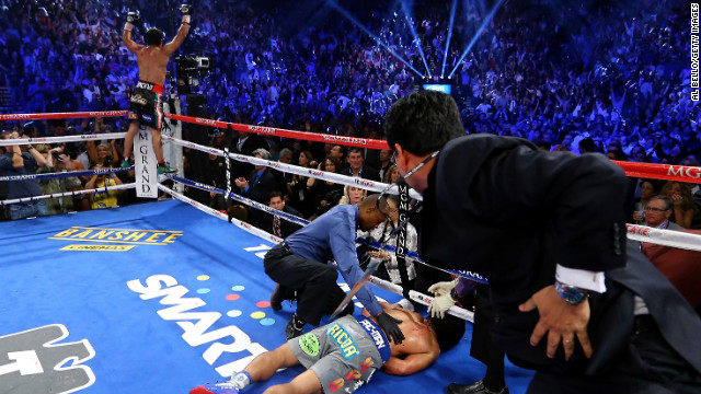 Manny Pacquiao lies face down on the mat after being knocked out in the sixth round by Juan Manuel Marquez, December 8.
