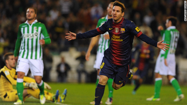 Lionel Messi celebrates after matching Gerd Muller's record of 85 goals in a calendar year, netting in the 16th minute of Barcelona's match against Real Betis. Just nine minutes later the Argentina star passed the German's 1972 milestone. 