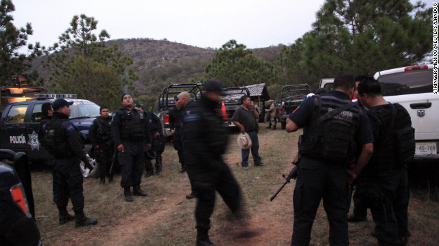 "Federal police work near the site of the plane crash in Iturbide, Mexico. ""The aircraft was destroyed, totally fragmented,"" an aviation official told CNN affiliate Televisa. Six others were killed, including the singer's publicist, attorney and makeup artists, her brother Gustavo Rivera told CNN en Espanol."