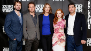 Screenwriter Mark Boal, left, and director Kathryn Bigelow, center, pose with cast members of \