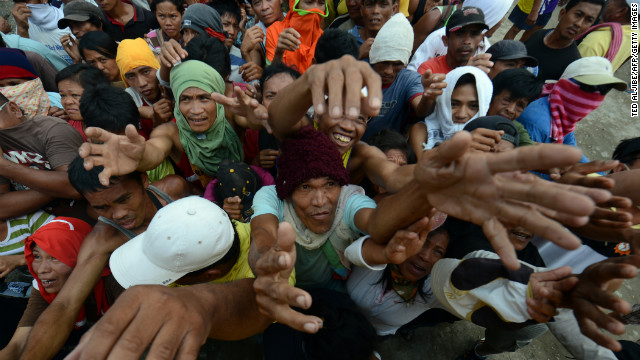 Victims of Typhoon Bopha jostle for position as they beg for relief food in New Bataan in Compostela Valley province on Sunday, December 9. Typhoon Bopha is the strongest cyclone to hit the Phillipines in decades, leaving hundreds dead and missing.