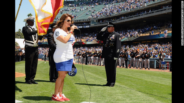 Rivera sings the national anthem at Dodger Stadium in Los Angeles in August 2012.