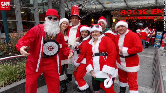 "<a href=''>Greg Reese</a> photographed these costumed attendees of Santacon 2012 in Cincinnati, Ohio. ""It's an annual event where they dress up like Santa and other holiday icons and walk around the city giving candy and [going on] pub crawls,"" he said."