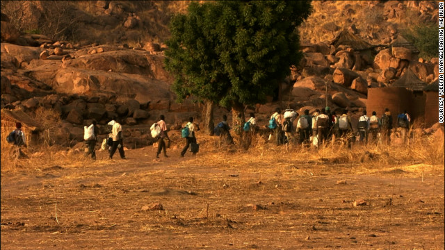 "In the film ""Erasing the Nuba"" Rwandan-born journalist Yoletta Nyange documented the plight of the Nuba people. In this scene from the film, a column of refugees flees to the Yida refugee camp in South Sudan."