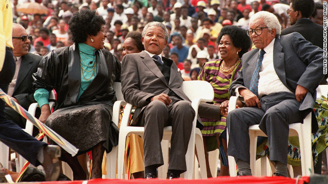Mandela attends a rally celebrating his release from jail at Soweto Soccer City stadium on February 13, 1990. More than 100,000 people attended the event.