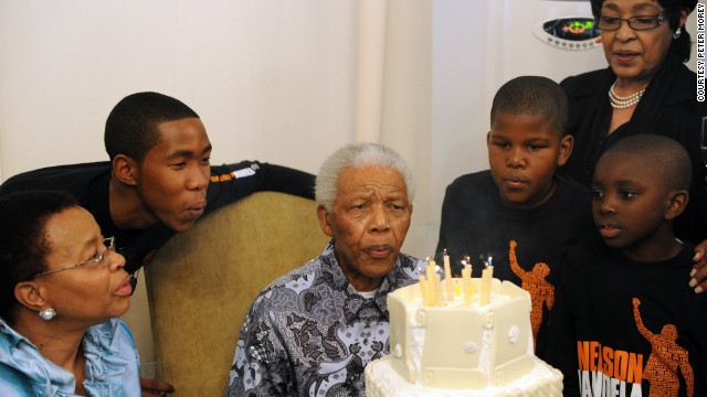 Surrounded by family members, Mandela celebrates his 92nd birthday at his home in Johannesburg on July 18, 2010.