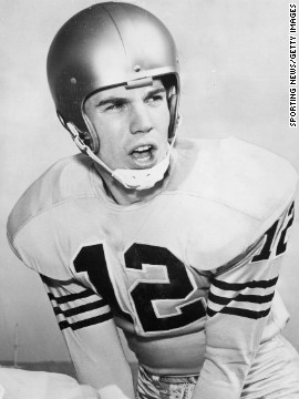 "Fleet-footed quarterback Roger Staubach wore No. 12 throughout his college and pro career with Navy and the Dallas Cowboys. A slippery fellow who earned the sobriquet ""Roger the Dodger,"" Staubach rushed for 2,264 yards and 20 touchdowns on top of his 153 passing touchdowns. The Heisman Trophy winner was drafted late in 1964 but went on to earn six Pro Bowl selections and win two Super Bowls, despite a four-year stint in the military that kept him out of the league until age 27. The NFL ranks him the 46th best player of all time."