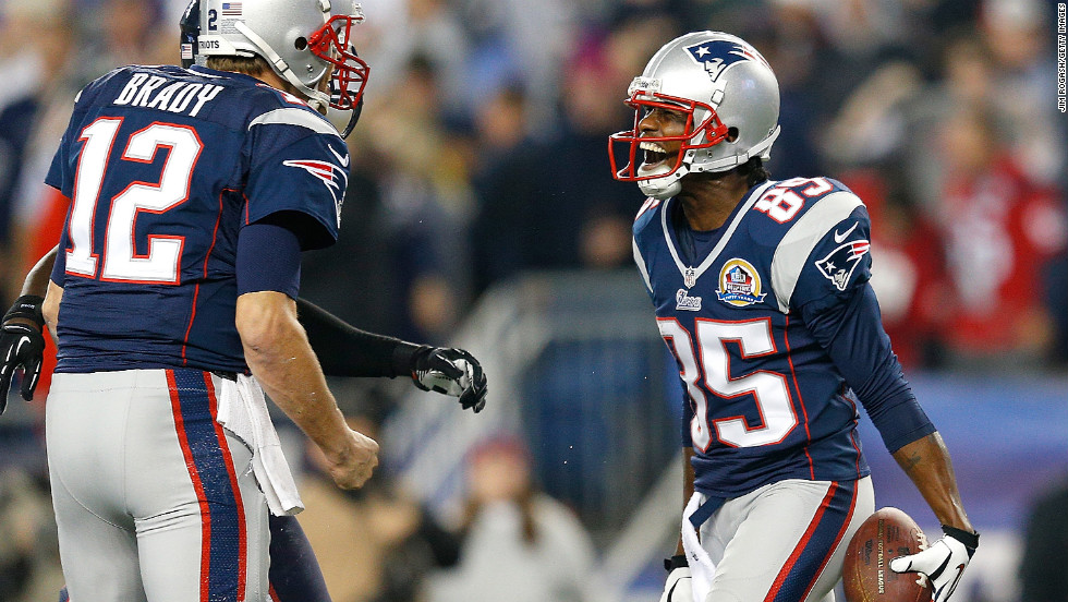 Brandon Lloyd of the New England Patriots, right, celebrates his touchdown with quarterback Tom Brady during the game against the Houston Texans on Monday, December 10, at Gillette Stadium in Foxboro, Massachusetts. Check out the action from Week 14 of the NFL and then <a href='http://www.cnn.com/2012/11/29/worldsport/gallery/nfl-week-13/index.html'>look back at the best photos from Week 13</a>.