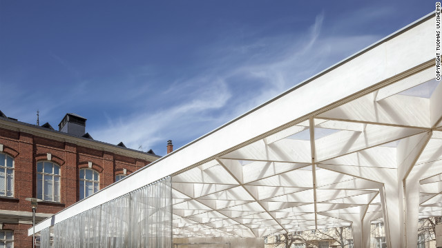 A lattice timber canopy gives a feeling of lightness to the pavilion. The structure will be recycled for a new architectural project next year.<br/><br/>© <a href='http://www.uusheimo.com' target='_blank'>Tuomas Uusheimo</a>