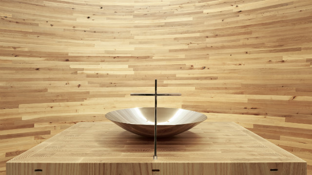 Inside the Kamppi Chapel, the curving inner wall is made out of alder planks into a closed space with light falling from above.<br/><br/>© <a href='http://www.uusheimo.com' target='_blank'>Tuomas Uusheimo</a>