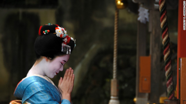 A maiko (apprentice geisha) rings a bell at a temple in Kyoto. As the clock ticks toward 2013, temples across the city will ring large bronze bells 108 times, a Buddhist tradition said to rid humans of earthly desires.