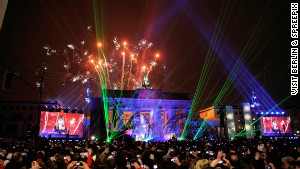 Revellers party in front of Berlin\'s Brandenburg Gate.