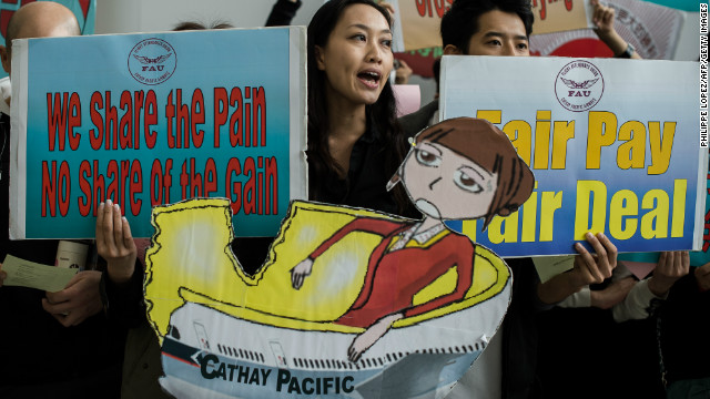 Cathay Pacific flight attendants stage a protest at the Hong Kong International Airport on December 3.