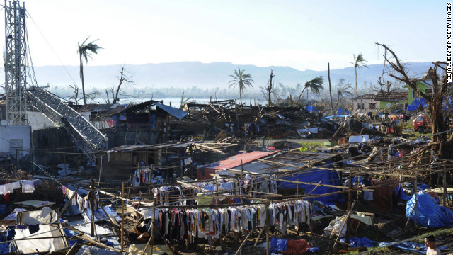Clothes hang next to destroyed houses and toppled trees in the town of Cateel, Davao Oriental province, on December 11.
