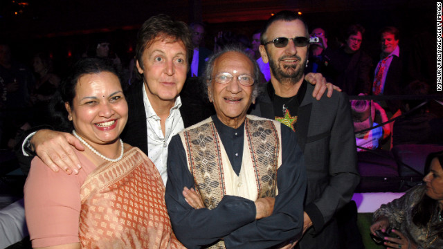 Shankar's wife, Sukanya Shankar, poses with her husband and Beatles Paul McCartney and Ringo Starr. 