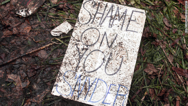 A trampled protestor's sign lies on the ground where union members rallied at the Michigan State Capitol.