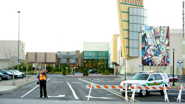 A mall security officer stands at the entrance to the Clackamas Town Center mall on Thursday.