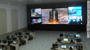 This picture from North Korea\'s Korean Central News Agency on December 12 shows the rocket Unha-3 being monitored at a satellite control center in North Korea.