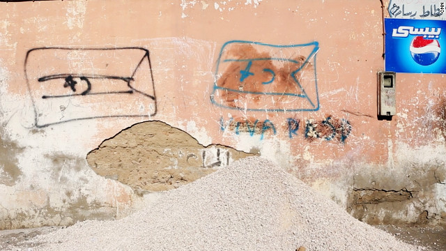 Graffiti of pro-Sahrawi independence flags on a street in Laayoune, the main city of Western Sahara. The city is in the region of the territory administered by Morocco.