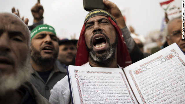 A supporter of Egypt's President Mohamed Morsy and the Muslim Brotherhood holds Quran as he shouts during a demonstration in Cairo on Friday, December 14.