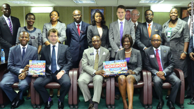 Nimi Akinkugbe (second from right, bottom row,) presenting the City of Lagos edition of Monopoly to the chief executive and directors of the Nigerian Stock Exchange earlier this week. She says the game is aiming to promote the city's history and landmark sites, but also to educate people about laws that are often overlooked.