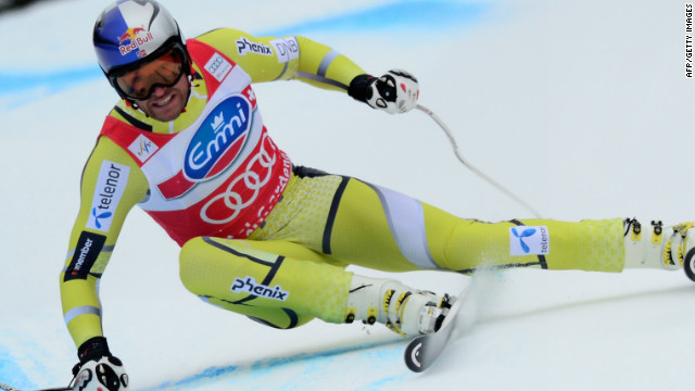 Aksel Lund Svindal powers his way to victory in the men's World Cup super-G at Val Gardena.
