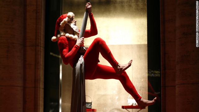 A man wearing a Santa Claus costume performs in downtown Rome on Thursday, December 13. 