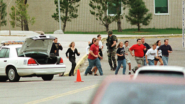 Columbine students run from the school in 1999. SWAT teams entered 47 minutes after the shootings started. In Arapahoe, the first officers entered almost immediately after the shooting was reported, the sheriff says.