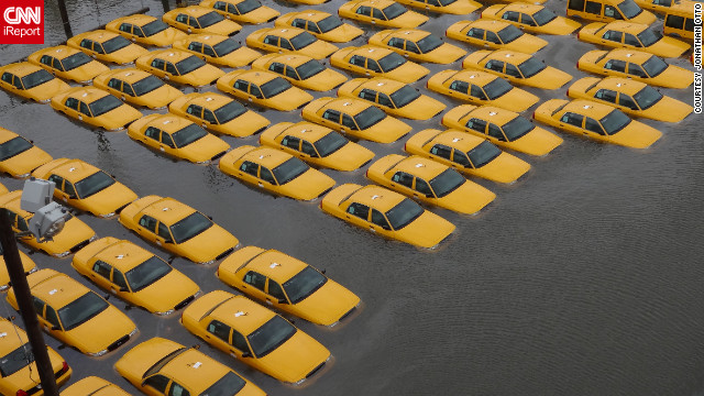 "A fleet of taxi cabs sat submerged in a flooded parking lot in Hoboken, New Jersey, after Superstorm Sandy hit the area in October. Photographer Jonathan Otto said, ""The picture was taken from the 14th street viaduct looking over the corner of Jefferson and 14th street, where it appears New York stores new cabs."""