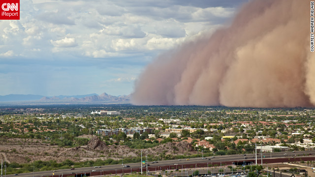 "A massive haboob, or dust storm, overtook <a href='http://ireport.cnn.com/docs/DOC-818051'>Phoenix, Arizona</a> in July, and Andrew Pielage knew he had to get it on camera. Racing up a mountain that was nearby, he skipped the official trail to get a better view and was able to capture it from a very unique angle. ""I had made it just in time. You really get a good and scary sense of the size and magnitude of these types of storms. It will be a photograph I will never forget."""