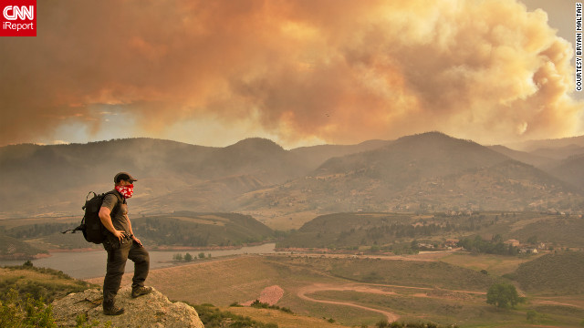 "June's High Park fire, caused by extreme drought conditions, could be seen from the Horsetooth Reservoir in Larimer County,<a href='http://ireport.cnn.com/docs/DOC-804593'> Colorado.</a> ""Climbing to this vantage point afforded me the opportunity to capture the fire crew on film at eye level as they flew by, and to look down into the heliport,"" said Bryan Maltais. ""I could also also photograph the unique atmospheric conditions that the fire created."""