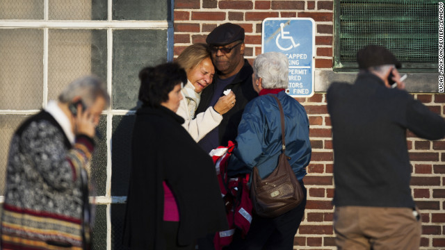 A woman leans on a man as she weeps near Sandy Hook Elementary School on December 14.