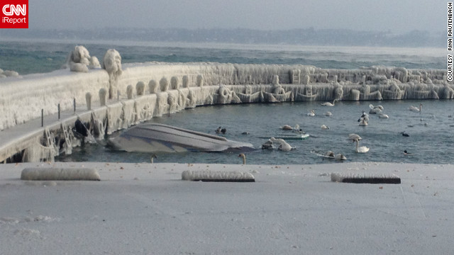 "Low temperatures in Switzerland helped freeze Lake Geneva in early February. Rita Rautenbach got this amazing shot at the time. ""'During the night and the day before, we had extreme temperatures where it got so cold that the spray made waves on the lake. As it sprays up it turns into ice immediately. It became layer on layer on layer. It became thick blocks of ice on the bench, on the cars."""