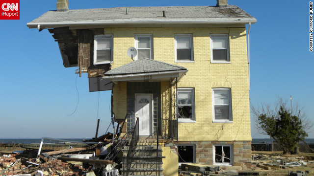 A house in <a href='http://ireport.cnn.com/docs/DOC-883706'>Union Beach, New Jersey</a>, was left standing despite being ripped apart from the winds of Superstorm Sandy in October. While photographing the area, Clifford Rumpf said each photo taken of the ravaged neighborhood was more shocking than the next. See more Sandy images <a href='http://ireport.cnn.com/open-story.jspa?openStoryID=865705'>here</a>.