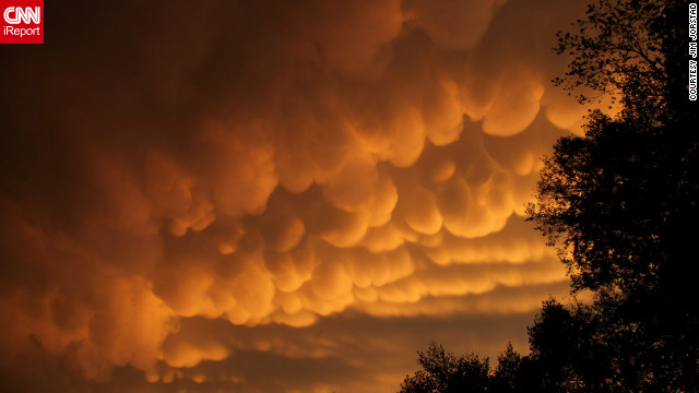 "Rare cloud formations, called <a href='http://ireport.cnn.com/docs/DOC-837418'>mammatus</a>, were spotted in La Crosse, Wisconsin in September. The name ""mammatus"" comes from the Latin word manna, or breast. ""After the storms rumbled through, I saw a yellow orange glow out the window,"" said Jim Jorstad. ""I then grabbed my camera, began driving several miles up the hill, stopping to take photos along the way."""